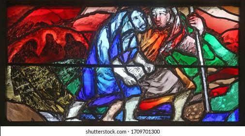 PIFLAS, GERMANY - JUNE 07, 2015: God's promise gives men courage and hope in the path of their lives and salvation, detail of stained glass window by Sieger Koder in St. John church in Piflas, Germany