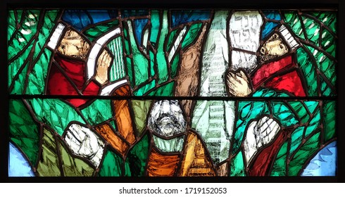 PIFLAS, GERMANY - JUNE 07, 2015: God, the Creator of all life, detail of stained glass window by Sieger Koder in church of Saint John in Piflas, Germany