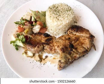 pig chop with white rice and salad