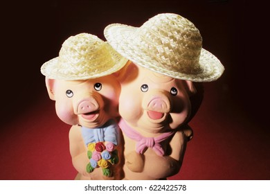 Pig Figurines on Red Background