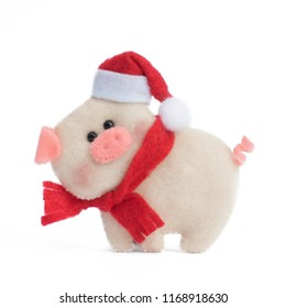 Pig handmade from felt on a white isolated background