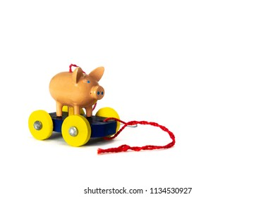 Pig on a wooden cart Christmas ornament