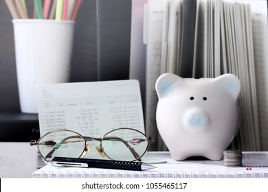 Pig piggy bank, coins, bank book, glasses. The concept of saving money