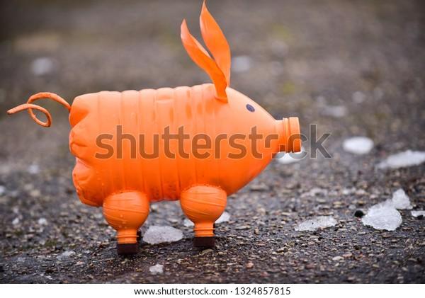 Pig from a plastic bottles. concept: waste management.
