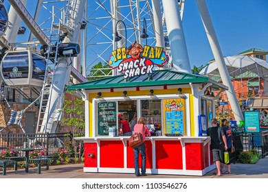 PIGEON FORGE ,TENNESSEE ,USA - MAY 11 ,2015 : Ferris wheel In the amusement park at Pigeon Forge, a famous tourist destination near the smoky mountains national park,Tennessee USA