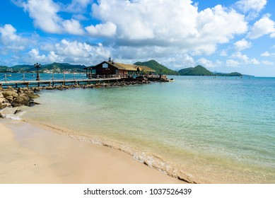 Pigeon Island Beach - tropical coast on the Caribbean island of St. Lucia. It is a paradise destination with a white sand beach and turquoiuse sea.
