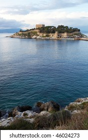 Pigeon Island Fortress, also known as the Pirates castle, in the Kusadasi harbor, on the Aegean coast of Turkey. Focus or Foreground rocks and water