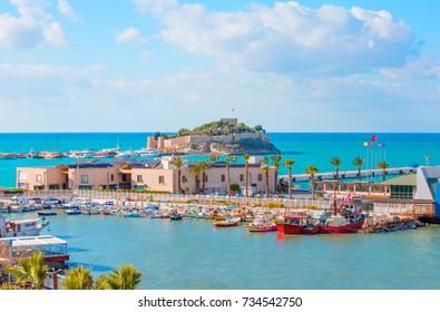 """Pigeon Island with a """"Pirate castle"""". Kusadasi harbor, Aegean coast of Turkey."""