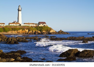 Pigeon Point Lighthouse on California Coast with Rocks and Waves