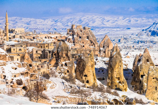 Pigeon Valley and Cave town in Goreme during winter time. Cappadocia, Turkey. Open air museum, Goreme national park. Heavenly landscape