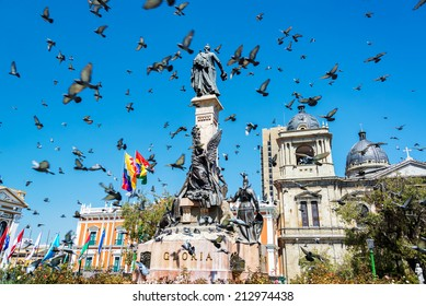 Pigeons flying around Plaza Murillo in La Paz, Bolivia