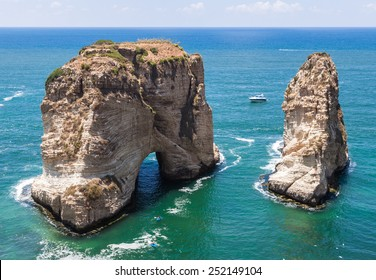 Pigeons' Rock limestone island in Beirut, Lebanon. City landscape of Beirut - capital of Lebanon. Beirut landmarks and famous places.