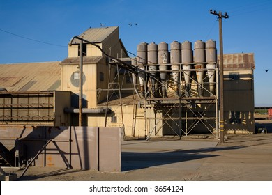 Pigeons roost on old agricultural processing plant in California's San Joaquin Valley