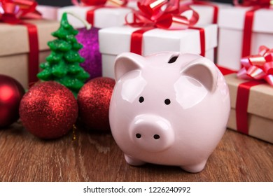 piggy bank with against the background of Christmas toys and gift boxes