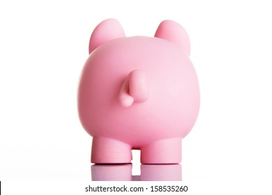 Piggy bank back. Isolated on white.