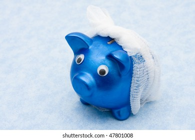 Piggy bank with a bandage over it on a blue background, Increasing health care costs