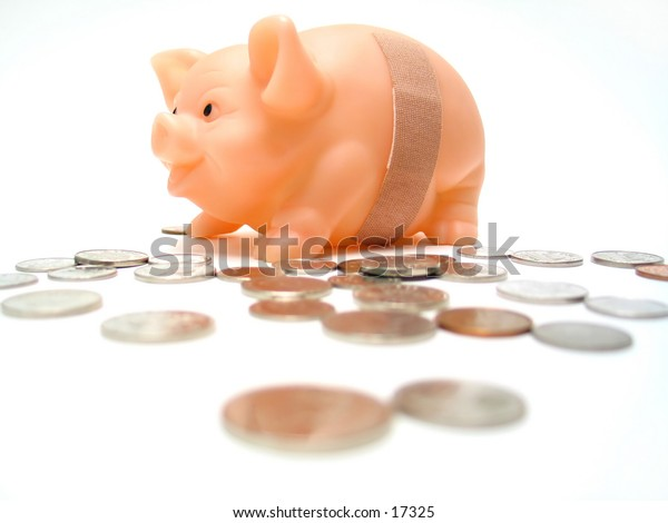 Piggy bank with a bandaid, money scattered across the floor. Piggy has been robbed :)