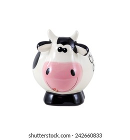 Piggy bank with black and white cow spots