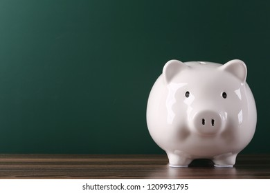 Piggy bank with blank background copy space.