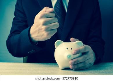 Piggy bank with businessman, business and finance concept, vintage color tone.