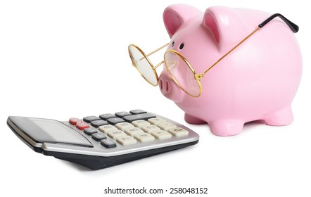 Piggy bank and calculator. Isolated on white background