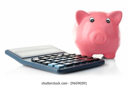 Piggy bank with calculator isolated on white