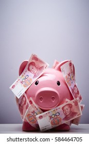 Piggy bank with Chinese yuan renminbi banknotes