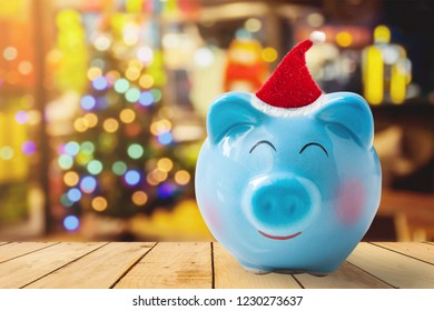 piggy bank with Christmas decoration background, image for time to start saving or solution to save money for Christmas celebration holiday vacation concept.