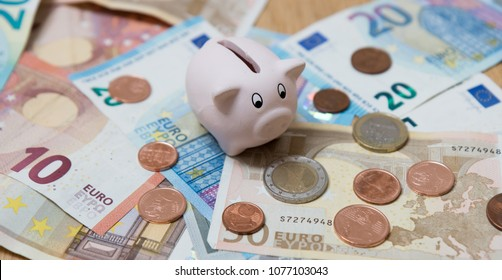 Piggy bank closeup, money and finance concepts. Photographed with Euro currency