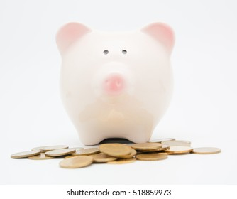piggy bank and coin on white