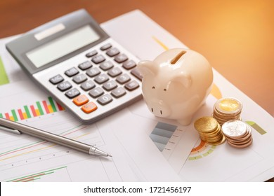 Piggy bank and coins for saving money with business stuff, Business and finance concept,