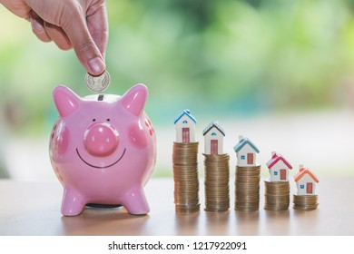 Piggy bank, concept of saving money for house , Business Finance and Money concept,Save money for prepare in the future.