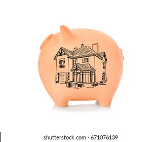 Piggy bank and drawing of house on white background. Concept of money and dream