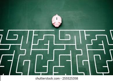Piggy bank entering into a maze.
