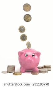 Piggy bank with Euros on white background.