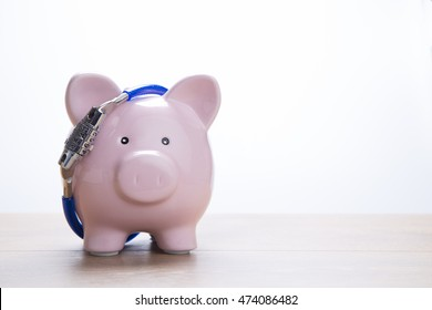 Piggy bank facing camera with locked chain