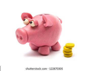 Piggy bank fashioned from clay in the children's style