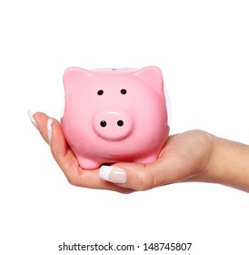Piggy bank in female hand isolated on white background. Savings