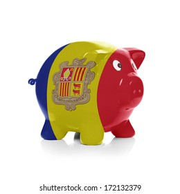 Piggy bank with flag coating over it isolated on white - Andorra