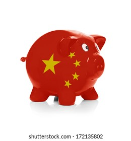 Piggy bank with flag coating over it isolated on white - China