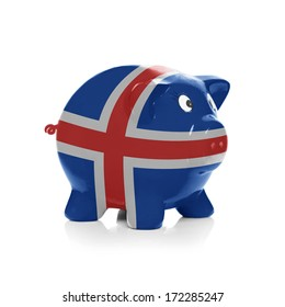Piggy bank with flag coating over it isolated on white - Iceland