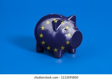 Piggy bank with Flag of European Union on blue background