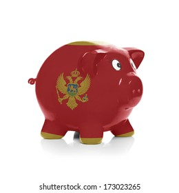 Piggy bank with flag painting over it isolated on white - Montenegro