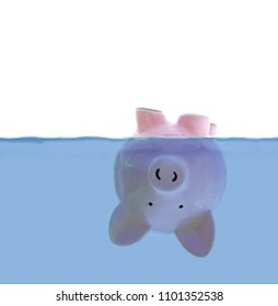 Piggy bank floating upside down under water, with white for copy space