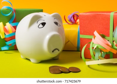 Piggy Bank with gift boxes, worried about money