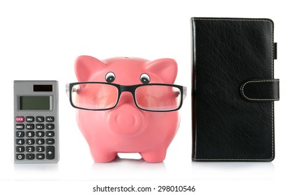 Piggy bank with glasses and calculator isolated on white