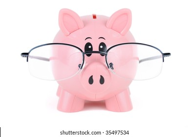 Piggy Bank in Glasses - educated piggy bank wearing glasses over white