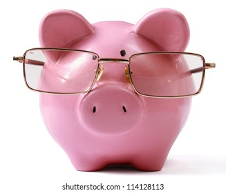 piggy bank with glasses in isolated white background
