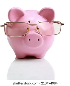 Piggy bank with glasses in isolated white