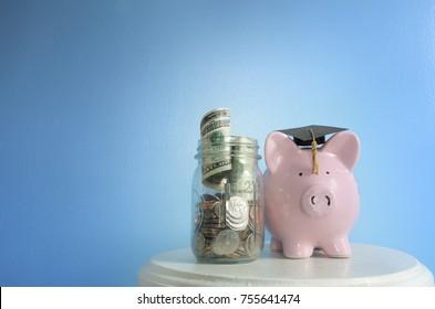 Piggy bank with graduation cap and coin jar